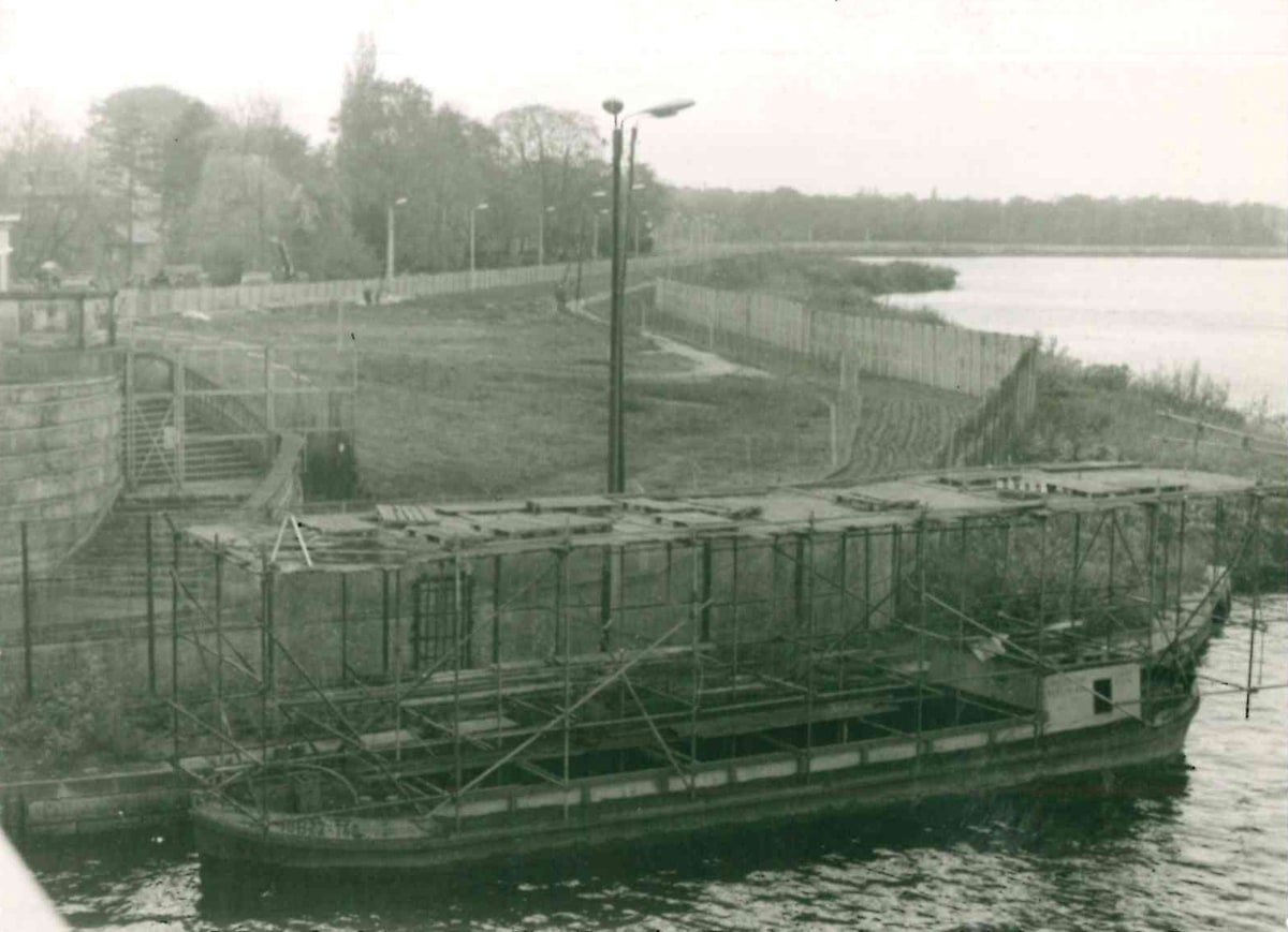 Repair work on the border crossing at Glienicke Bridge with a view of the frontier barriers